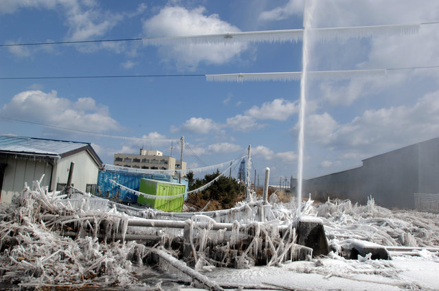 In this handout image provided by U.S. Navy, A water pipe spews water after being damaged by a tsunami, which was triggered by a massive earthquake off the Northeastern coast March 12, 2011 in Hachinohe, Japan.  An earthquake measuring 8.9 on the Richter scale has hit the northeast coast of Japan causing tsunami alerts throughout countries bordering the Pacific Ocean. (Photo by Daniel Sanford/ U.S. Navy via Getty Images)