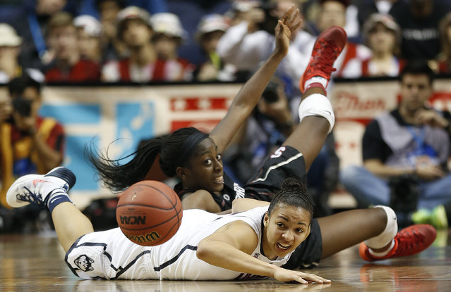 Stanford forward Chiney Ogwumike (13) and Connecticut guard Bria Hartley (14) collide during the second half of the semifinal game in the Final Four of the NCAA women's college basketball tournament, Sunday, April 6, 2014, in Nashville, Tenn. Connecticut won 75-56. (Photo by John Bazemore/AP Photo)