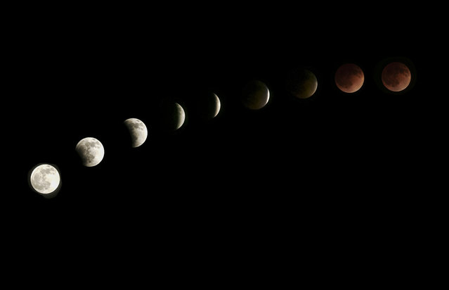 "The moon is seen as it nears a total lunar eclipse on April 15, 2015 in Venice, California. People in most of north and south America should be able to witness the year's first total lunar eclipse, which will cause a ""blood moon"" and is the first of four in a rare Tetrad of eclipses over the next two years. (Photo by Rich Polk/Getty Images)"
