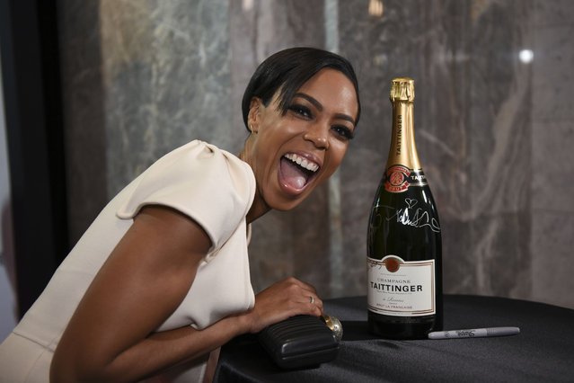 Actress Jazmyn Simon, of HBO's Ballers, poses with a magnum of Champagne Taittinger for the SAG/AFTRA Foundation, during the Celebrate Journalists event at the Washington Post Headquarters on Friday, April 29, 2016, in D.C. The event kicked off festivities for the 102nd White House Correspondents' Dinner. (Photo by Kevin Wolf/Invision for Taittinger/AP Images)