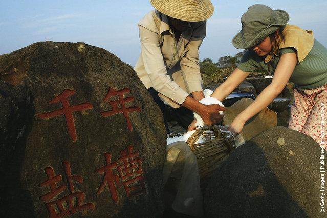 Villagers Evaporate Brine At Ancient Salt Fields