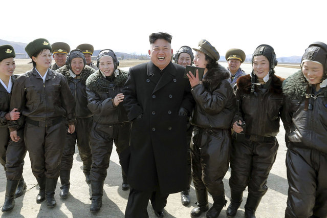 North Korean leader Kim Jong Un supervises a flight drill of the KPA Air and Anti-Air Force Unit 2620, honored with the Title of O Jung Hup-led 7th Regiment, in this undated photo released by North Korea's Korean Central News Agency (KCNA) March 7, 2014. (Photo by Reuters/KCNA)