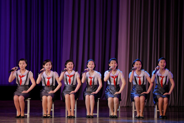 Girls perform on the stage of the Mangyongdae Children's Palace in central Pyongyang, North Korea May 5, 2016. (Photo by Damir Sagolj/Reuters)