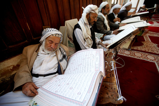 A man rests while reading the Koran at the Grand Mosque, during the holy month of Ramadan in Sanaa, Yemen on May 30, 2019. (Photo by Mohamed al-Sayaghi/Reuters)