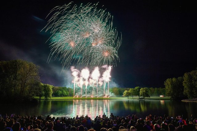"""A firework display is set off during the annual """"Rhein in Flammen"""" (Rhine in Flames) event in Bonn, Germany, 07 May 2016. On five occasions between May and September, the Rhine river valley from Ruedesheim and Bonn is illuminated with fireworks. (Photo by Volker Lannert/EPA)"""