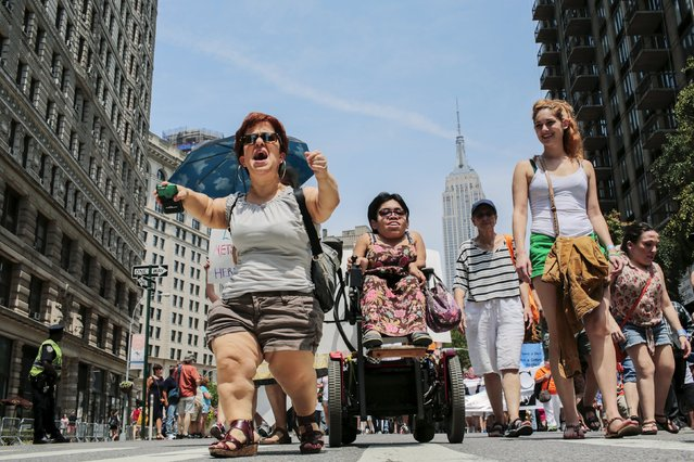 Michelle Kraus (L), 45, suffering from dwarfism shouts slogans to support disabled people while she takes part in the disability pride parade in New York, July 12, 2015. (Photo by Eduardo Munoz/Reuters)