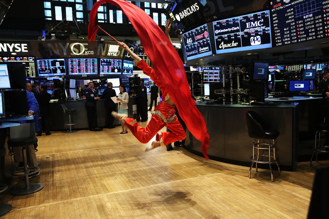 A dancer for the Hong Kong Economic and Trade Office, which rang the Opening Bell, is viewed on the floor of the New York Stock Exchange (NYSE) on July 27, 2015 in New York City. The Dow Jones industrial average was down 150 points in morning trading following a steep overnight decline in the volatile Chinese exchange. (Photo by Spencer Platt/Getty Images)