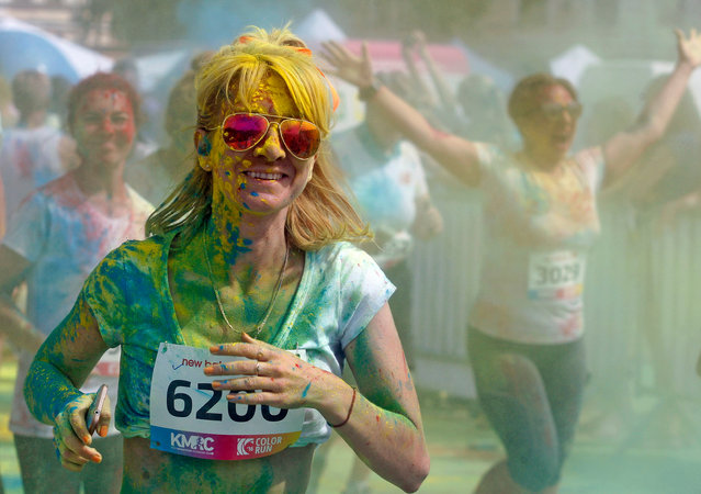 The annual Colour Run through the city, inspired by the Hindu Holi festival in Kiev, Ukraine on June 6, 2016. (Photo by Vasyl S./Pacific/Barcroft Images)