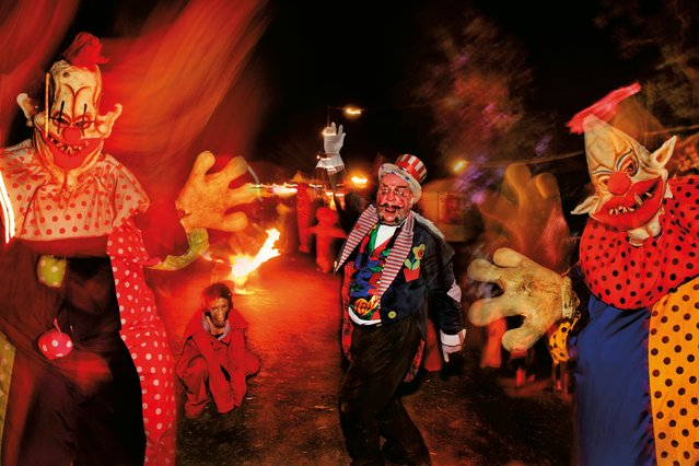 Scary clowns! Street circus performers in the Shangri-La field, Glastonbury, 2008. (Photo by Barry Lewis/The Guardian)
