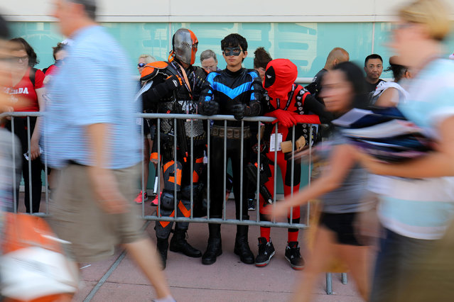 """Chris Meeham (C) , dressed as """"Nightwing"""", waits in line with friends for the opening preview night  at Comic Con International in San Diego,California, U.S., July 19, 2017. (Photo by Mike Blake/Reuters)"""