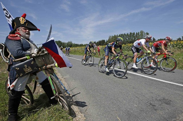 The pack of riders cycles on its way during the 197.5km 13th stage of the Tour de France cycling race between Saint-Etienne and Chamrousse, July 18, 2014. (Photo by Jacky Naegelen/Reuters)