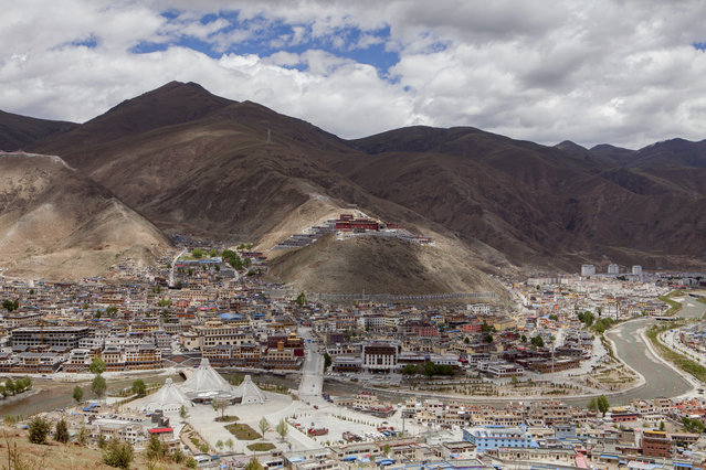 View of Yushu, a county-level city of Yushu Tibetan Autonomous Prefecture in the southern part of Qinghai province on May 30, 2016. The city is at 3700m above sea level. Atop the hill lies the Thrangu Monastery, which was in part destroyed by the earthquake in 2010 and is now rebuilt. (Photo by Giulia Marchi/The Washington Post)