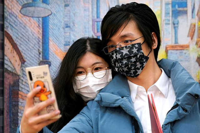 Wang, 32, and his wife Shi, 30, wearing masks are seen at a marriage registry office on Valentine's Day in Shanghai, China, as the country is hit by an outbreak of the novel coronavirus, February 14, 2020. (Photo by Aly Song/Reuters)