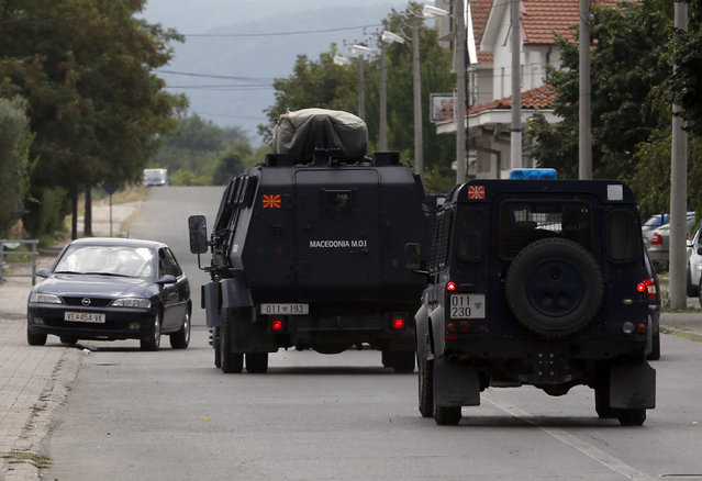 Police vehicles drive to the border between Greece and Macedonia in the southern Macedonian town of Gevgelija, Thursday, August 20, 2015. Macedonian  police  stepped up the security at the border with Greece apparently trying to stem recent surge of migrants who are coming from Greece. (Photo by Darko Vojinovic/AP Photo)