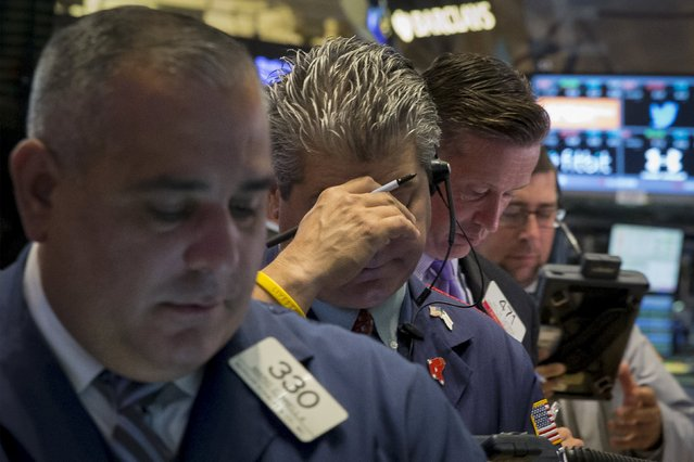 Traders work on the floor of the New York Stock Exchange August 24, 2015. (Photo by Brendan McDermid/Reuters)
