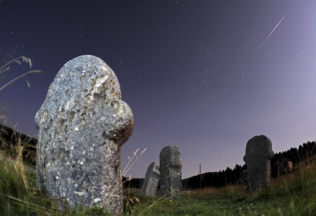 A meteor streaks over the sky during the Perseid meteor shower at the Maculje archaeological site near Novi Travnik August 12, 2014. According to NASA, the annual Perseid meteor shower reaches its peak on August 12 and 13 in Europe. The fireballs from the meteorites are fast and plentiful, although a nearly full moon (Supermoon) makes it difficult to view them this year, the agency adds. (Photo by Dado Ruvic/Reuters)