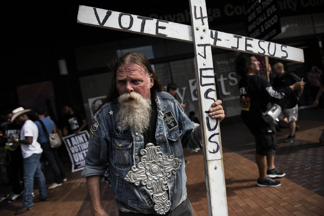 Gary Mathes walks the streets of downtown Cleveland on July 18, 2016. Mathes came to town for the Republican National Convention which started today. (Photo by Michael Robinson Chavez/The Washington Post via Getty Images)