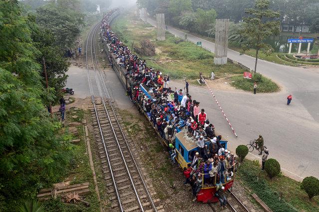 "Muslim devotees leave after taking part in the Akheri Munajat, or final prayers, during the annual Muslim gathering ""Biswa Ijtema"" in Tongi, some 30 kms north of Dhaka on January 12, 2020. (Photo by Munir Uz Zaman/AFP Photo)"