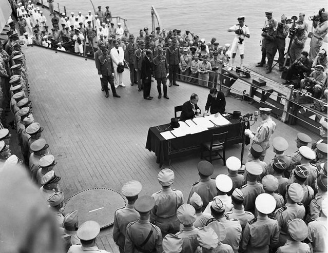 Japan's delegation gather to sign the formal surrender document on the U.S. Navy battleship USS Missouri in Tokyo Bay in a September 2, 1945 file photo. (Photo by Reuters/US Navy)