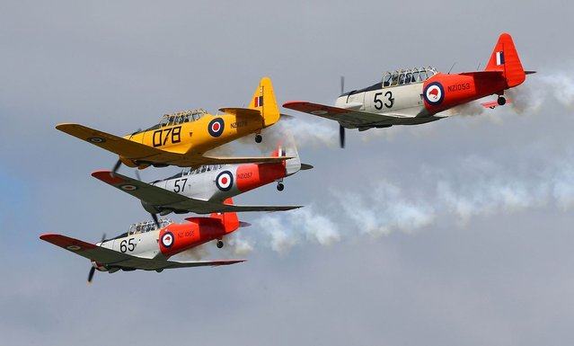 ARDMORE, NEW ZEALAND - SEPTEMBER 28:  The Roaring 40's Harvard display team perform during an airshow commemorating the rebuild of Havilland Mosquito KA 114, on September 29, 2012 in Ardmore, New Zealand. The plane was restored by Warbird Restorations at Ardmore Aerodrome and is the only flying Mosquito in the world.  (Photo by Simon Watts)