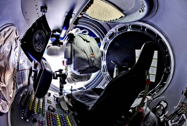 24 miles up, Baumgartner prepares to jump from the capsule. (Photo by Jay Nemeth/Red Bull Stratos)