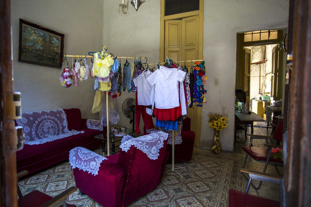 Childrens clothes hang for sale inside a resident's living room in Havana, Cuba, Tuesday, May 24, 2016. (Photo by Desmond Boylan/AP Photo)