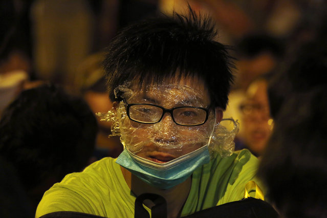 "A protester wearing rudimentary protection against pepper spray is pictured during a confrontation with the police, after a rally for the October 1 ""Occupy Central"" civil disobedience movement in Hong Kong September 27, 2014. (Photo by Bobby Yip/Reuters)"