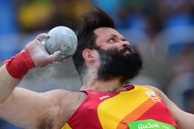 Spain's Carlos Tobalina competes in the Men's Shot Put Qualifying Round during the athletics event at the Rio 2016 Olympic Games at the Olympic Stadium in Rio de Janeiro on August 18, 2016. (Photo by Franck Fife/AFP Photo)