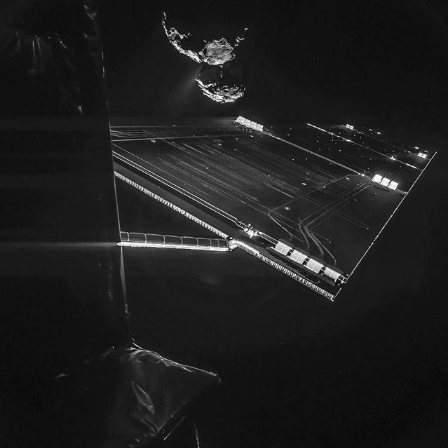 An unmanned probe that will next month attempt to become the first spacecraft to land on a comet has sent back a photo of its intended target. The image captures the side of the Rosetta spacecraft and one of its 46-foot-long solar wings, with comet 67P/Churyumov-Gerasimenko visible in the background at a distance of ten miles. (Photo by ESA/Rosetta/Philae/CIVA via AFP Photo)
