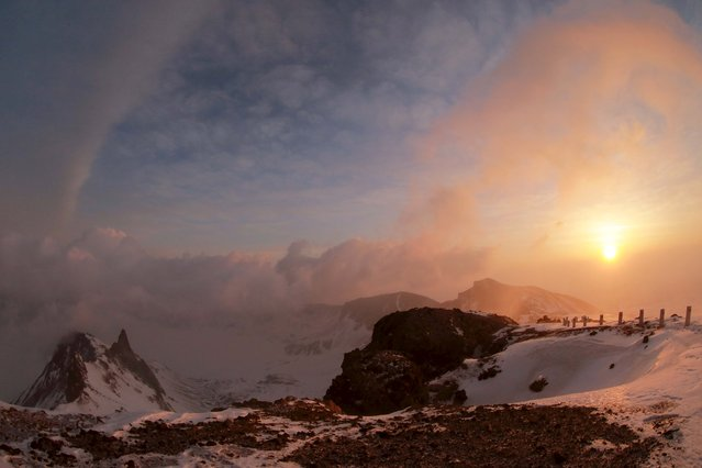 A view of the dawn from the summit of Mt Paektu April 18, 2015 in this photo released by North Korea's Korean Central News Agency (KCNA) on April 19, 2015. (Photo by Reuters/KCNA)