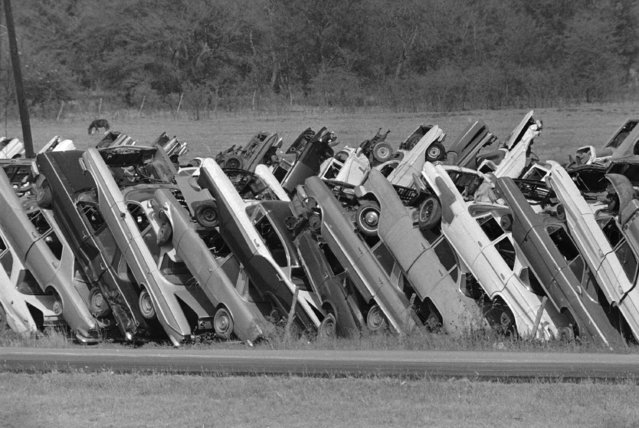 Cars stacked like dominoes form a fence around a junk yard on Interstate 45 north of Ferris, Tex., October 11, 1972.  (Photo by Ferd Kaufman/AP Photo)