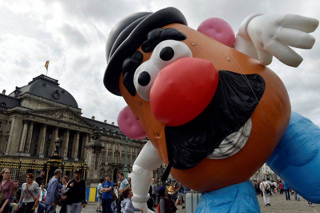 A giant balloon of Mister Potato Head floats during the Balloon Day Parade in central Brussels September 4, 2016. (Photo by Eric Vidal/Reuters)