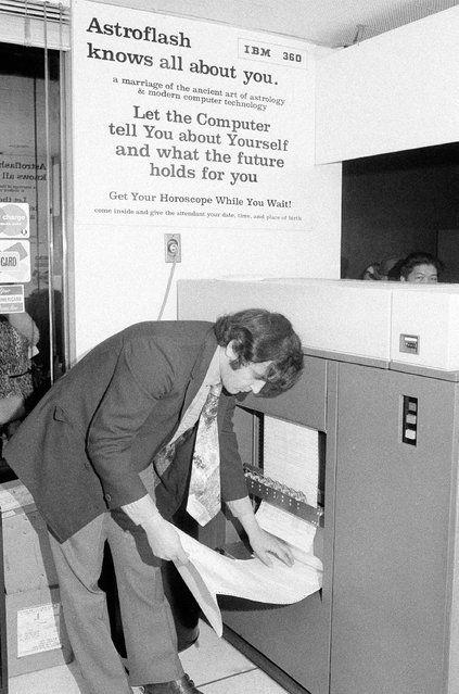 """At the """"Astroflash"""" office in Grand Central Terminal in New York January 18, 1971. Your horoscope is computed by IBM machines after you give your day, month, and year of birth, plus city and state, and, if possible, the exact hour. IBM card in punched with this data, and then run through the computer, which spills out your character portrait and a six-month forecast on many sheets of computer copy, costs $10.00. There are other, mote economical readings to be had. The computer operator is Joseph Chillo; the receptionist is Maryliz (cq) Scott. The girl reacting to her horoscope is Elizabeth Speert. (Photo by John Lent/AP Photo)"""