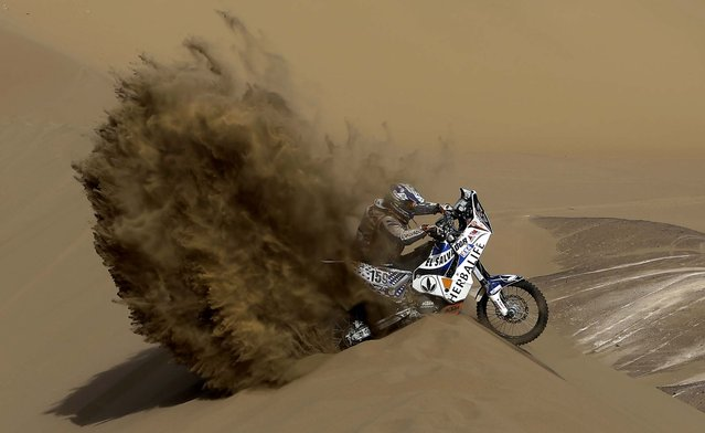 KTM rider Jorge Aguilar of Salvador tries to get out of a dune during the 6th stage of the 2013 Dakar Rally from Arica to Calama, Chile, Thursday, January 10, 2013. The race finishes in Santiago, Chile, on January 20. (Photo by Victor R. Caivano/AP Photo)