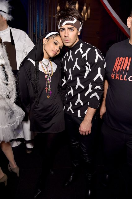 Zoe Kravitz and Joe Jonas attend Moto X presents Heidi Klum's 15th Annual Halloween Party sponsored by SVEDKA Vodka at TAO Downtown on October 31, 2014 in New York City. (Photo by Mike Coppola/Getty Images for Heidi Klum)