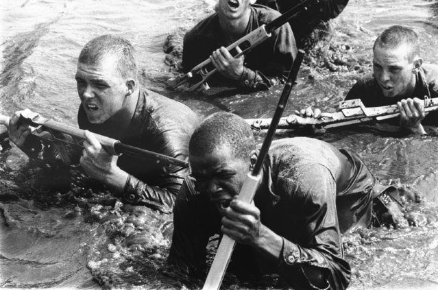 Recruits who earned a place in the Motivation Platoon struggle through water and muck on their way to becoming a Marine or going into some other line of work, October 7, 1971. (Photo by Eddie Adams/AP Photo)
