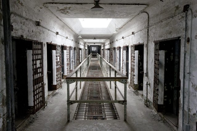 This October 13, 2014, photo shows cellblock 12 at Eastern State Penitentiary in Philadelphia. The penitentiary took in its first inmate in 1829, closed in 1971 and reopened as a museum in 1994. (Photo by Matt Rourke/AP Photo)
