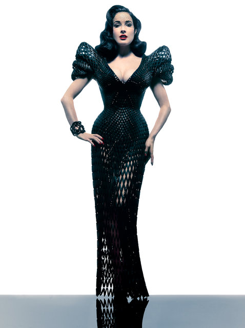 New York designer Michael Schmidt and architect Francis Bitonti have created a 3D-printed dress for burlesque dancer Dita Von Teese. The floor-length nylon gown was made using selective laser sintering (SLS), where material is built up in layers from plastic powder fused together with a laser. The rigid plastic components are fully articulated to create a netted structure that allows for movement. Spirals based on the Golden Ratio were applied to a computer rendering of Von Teese's body so the garment fits her exactly. (Photo by Jeff Meltz)