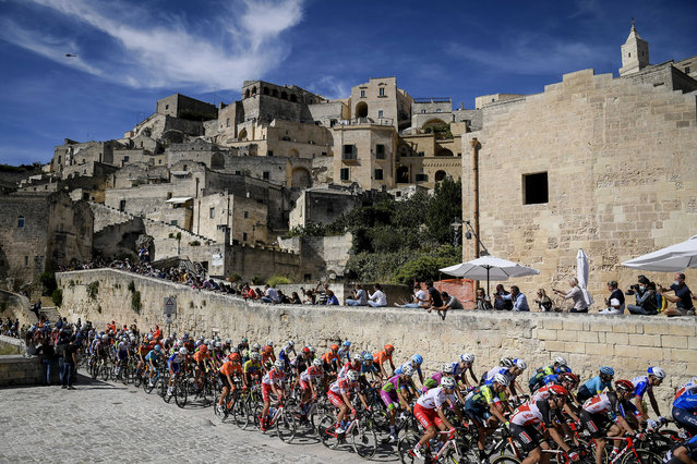 The pack of cyclists pedals past Matera at the start of the seventh stage of the Giro d'Italia cycling race, from Matera to Brindisi, southern Italy, Friday, October 9, 2020. (Photo by Fabio Ferrari/LaPresse via AP Photo)