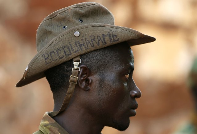 "A Seleka fighter wears a hat that reads ""Bocou Harame"", in a reference to the Islamist militant group Boko Haram, in the town of Bria, in this April 9, 2014 file photo. (Photo by Goran Tomasevic/Reuters)"