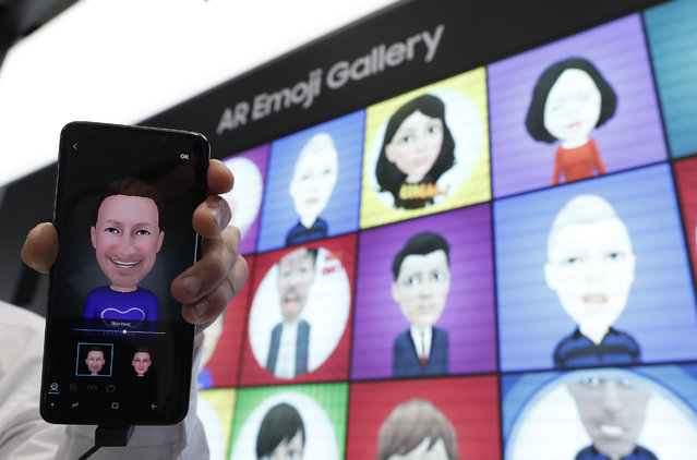A Samsung Galaxy S9 is displayed with an AR emoji at the Samsung booth at the Mobile World Congress in Barcelona, Spain, February 26, 2018. (Photo by Yves Herman/Reuters)