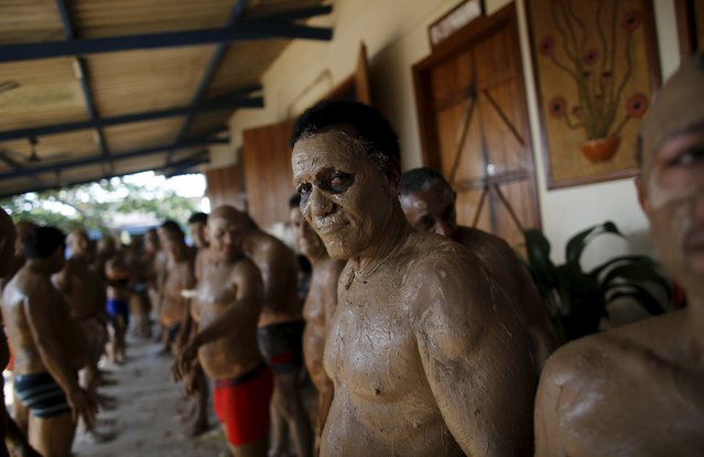 Prisoner Roque Pereira, 65, is covered in clay during a therapy session as part of the ACUDA programme, at a complex of ten prisons in Porto Velho, Rondonia State, Brazil, August 28, 2015. According to ACUDA, prisoners spend most of their hours in dank, dark cells and the clay therapy is designed to improve their skin. It is part of an alternative therapy programme the charity uses to address the physical and emotional needs of inmates. (Photo by Nacho Doce/Reuters)