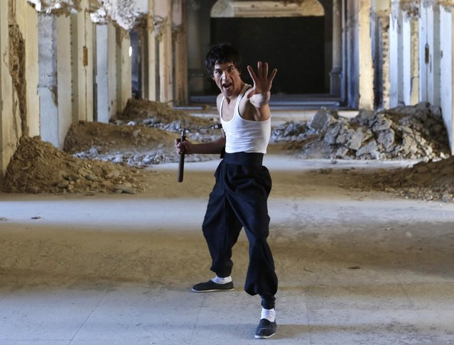 Abbas Alizada, who calls himself the Afghan Bruce Lee, poses for the media in Kabul December 9, 2014. (Photo by Mohammad Ismail/Reuters)