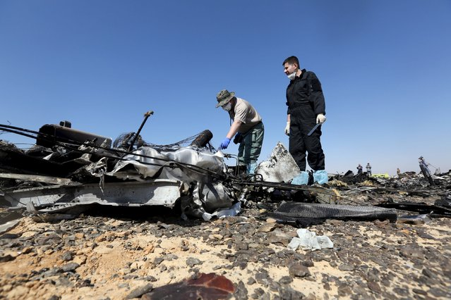 Military investigators from Russia check debris from a Russian airliner at its crash site at the Hassana area in Arish city, north Egypt, November 1, 2015. (Photo by Mohamed Abd El Ghany/Reuters)