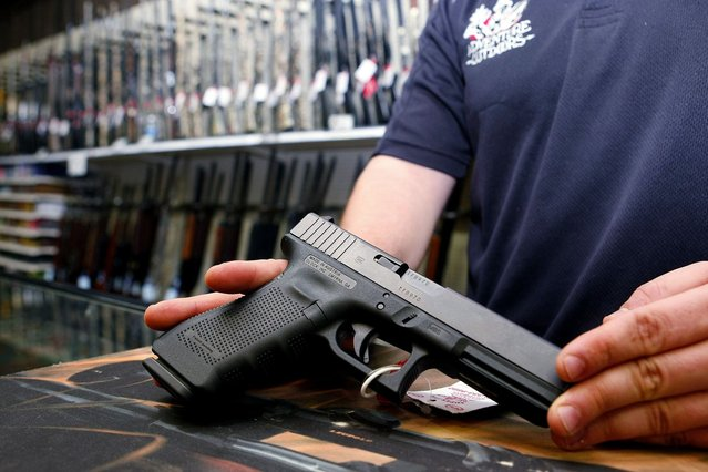 "A Glock handgun available in a raffle promotion is shown at Adventures Outdoors in Smyrna, Georgia, October 25, 2012. The store has promoted the raffle on billboards as a ""Vote. Win a rifle"". but owner Jay Wallace has stated that all Georgia residents are eligible to enter. (Photo by Tami Chappell/Reuters)"