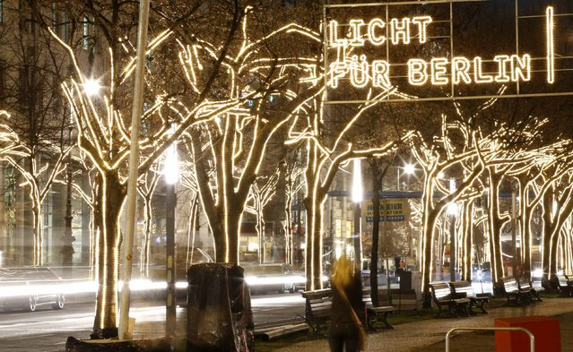 Trees illuminated by Christmas lights are pictured on Unter den Linden street near the Brandenburg Gate in Berlin, December 9, 2014. Picture taken with long exposure. (Photo by Fabrizio Bensch/Reuters)
