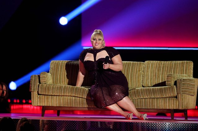 Host Rebel Wilson, who won the award for breakthrough performance, speaks onstage. (Photo by Matt Sayles/Invision)