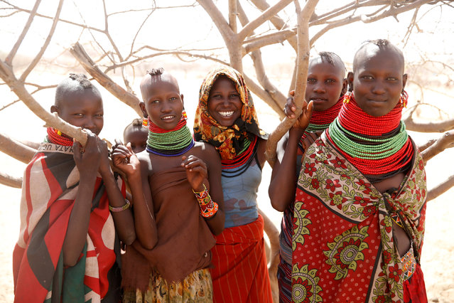 Turkana girls are seen at a waterhole near Lokichar, Turkana County, Kenya, February 7, 2018. (Photo by Baz Ratner/Reuters)