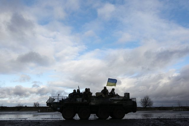 Ukrainian servicemen sit atop an armored personnel carrier (APC) at a military base in the town of Kramatorsk, eastern Ukraine, December 24, 2014. (Photo by Valentyn Ogirenko/Reuters)