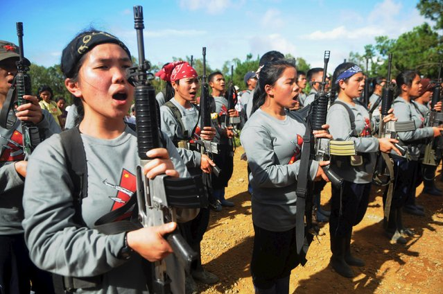 "Members of the New People's Army (NPA) female guerrillas perform a cultural show during the release of a Philippines army soldier in Sugbongcogon town, Misamis Oriental, southern Philippines, November 20, 2015. NPA spokesperson Allan Juanito warned that they will seize more soldiers to exchange them with the government as ""Prisoners of war"". (Photo by Froilan Gallardo/Reuters)"